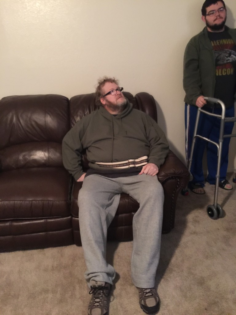 Here's John sitting on his couch...he was able to sit and get up on his own.